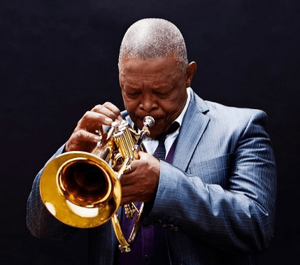 hugh masekela blowing trumpet