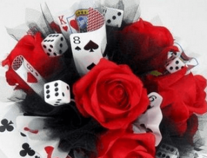 roses are mixed with dices and playing cards