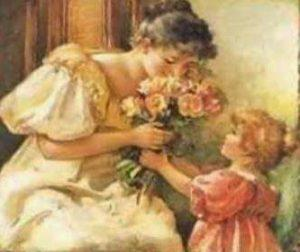 picture of young girl giving flowers to her mother