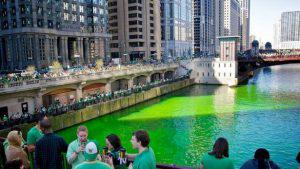 people in chicago celebrating St Patricks day by dyeing the river