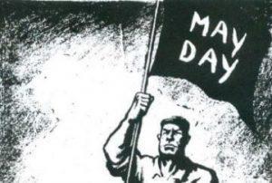 Man holding Mayday banner