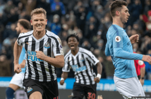 Matt Ritchie celebrating victory over Manchester City